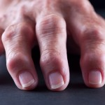 Selective-focus image of Arthritic/Senior Adult Hands shot on black