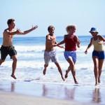 Young Men Chasing Young Women at Beach